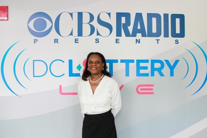 DC SPOTLIGHT - PHOTO CBS STEVE SWENSON & WENDY INTERVIEW Wendy DC Lottery CBS wall